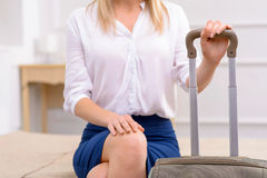 Girl  with luggage in her hotel suite Stock Photos