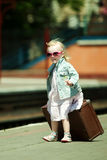 Girl with luggage at the railway station Royalty Free Stock Photography