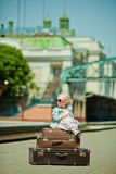 Girl with luggage at the railway station Royalty Free Stock Photo