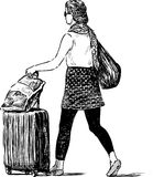 Girl with a luggage Royalty Free Stock Photos