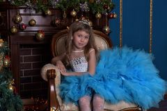 Girl with lush blue dress Royalty Free Stock Image