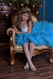 Girl with lush blue dress Stock Images