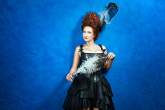 Girl with lush hair high in a corset and skirt. Royalty Free Stock Photography
