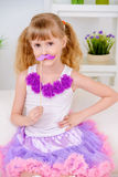 Girl in lush skirt. Cute little girl in beautiful lush skirt play with mask. Kid`s fashion, beauty Stock Images