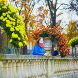 Girl in the Luxembourg garden of Paris on a fall day Royalty Free Stock Image