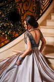 Girl in a luxurious, evening dress royalty free stock photography