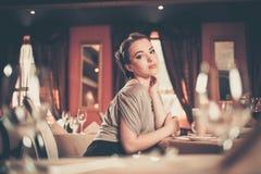 Girl in luxury restaurant interior Stock Images