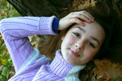 The girl lying  on autumn leaves Stock Photography