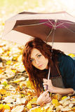 Girl is lying on autumn leaves Royalty Free Stock Image