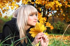 Girl lying on autumn leaves Royalty Free Stock Images
