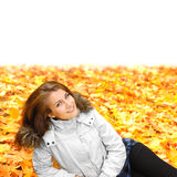 Girl lying in autumn park Royalty Free Stock Photos