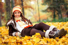 Girl lying  autumn park Royalty Free Stock Photography