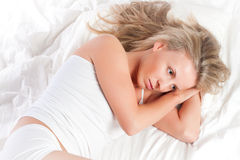Girl lying in bad Stock Photography