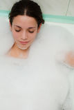 Girl lying in bath Royalty Free Stock Images
