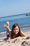 Girl lying on beach Royalty Free Stock Photo