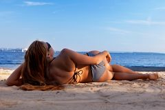 Girl lying on a beach Stock Image