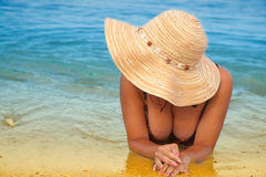 Girl is lying on the beach. Stock Images