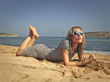Girl lying at the beach Stock Photos