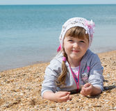 girl lying on the beach royalty free stock images