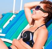 Girl lying on a beach lounger Royalty Free Stock Photos