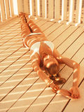 Girl lying in the beach pergola Royalty Free Stock Photography