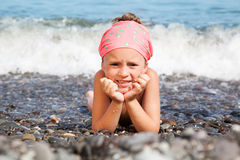 Girl lying on the beach Stock Image