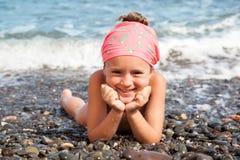 Girl lying on the beach Stock Photo