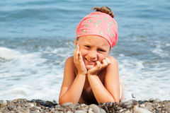 Girl lying on the beach Royalty Free Stock Photos