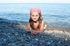 Girl lying on the beach Royalty Free Stock Photos