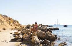 Girl lying on the beach, sunbathing and relaxing. Summer journey to sea. Royalty Free Stock Photos
