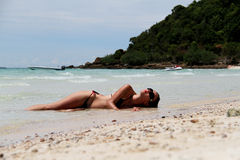 Girl lying on the beach. Royalty Free Stock Photos