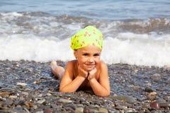 Girl lying on the beach Royalty Free Stock Photo