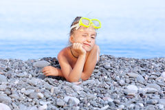 Girl lying on the beach Royalty Free Stock Photo