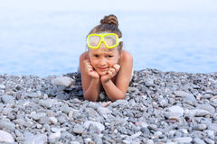 Girl lying on the beach Stock Photos