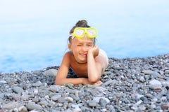 Girl lying on the beach Stock Photos