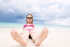 Girl lying on the beachfront Royalty Free Stock Images