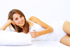 Girl lying on the bed Stock Photo