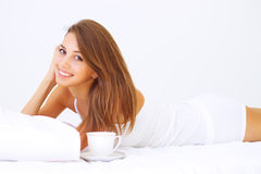 Girl lying on the bed Royalty Free Stock Image