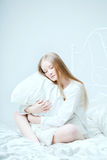 Girl lying on the bed Royalty Free Stock Images