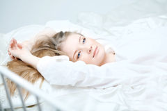 Girl lying on the bed Royalty Free Stock Photos