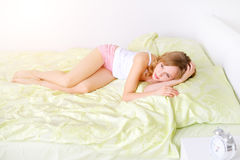 Girl lying on a bed Royalty Free Stock Photo