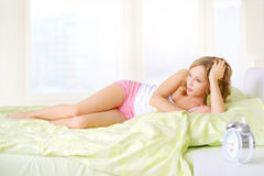 Girl lying on a bed Stock Photography
