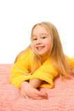 Girl lying on a bed Royalty Free Stock Image