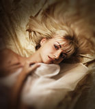 Girl lying in a bed Stock Photo