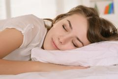 Girl lying in bed Stock Image