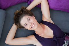 Girl lying on the bed with big smile Stock Images