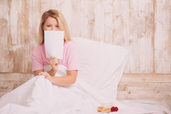 Girl lying in bed with copy space Stock Photography