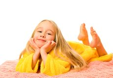 Girl lying on a bed and dreaming stock images
