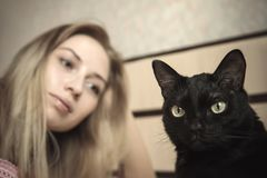 Girl lying in bed with her cat Royalty Free Stock Photo