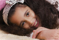 Girl lying in the bed Stock Photo